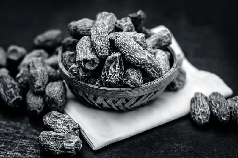 Dried dates or Kharek in a basket also known as Phoenix dactylifera served as a sweetener with lunch. stock image