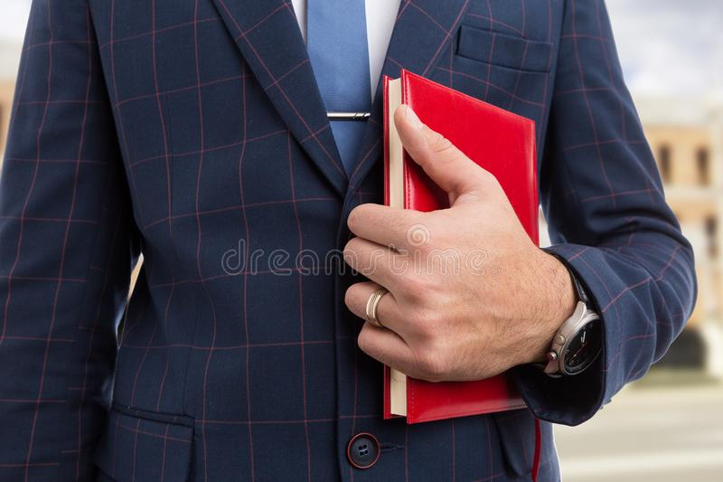 Close-up of real estate agent holding agenda royalty free stock photos
