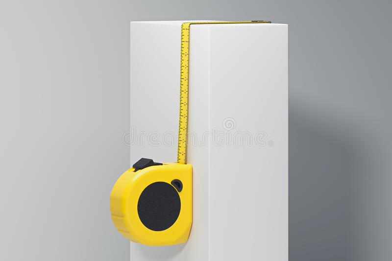 Close up of realistic yellow measure ruler on white cube. 3d rendering, stock illustration