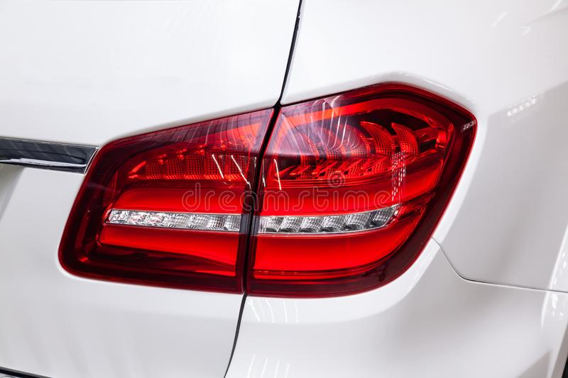 Close-up on the rear LED brake light of red color on a white car in the back of a suv after cleaning, polishing and detailing in. The vehicle repair workshop royalty free stock images