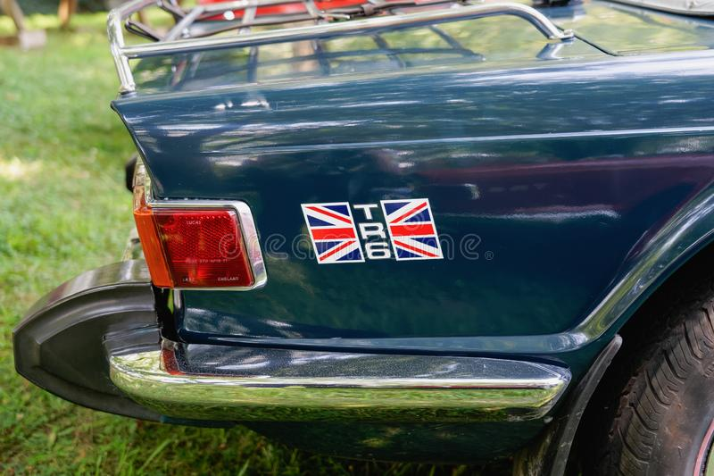 Close up of the rear quarter panel of a dark green Triumph TR6 stock images