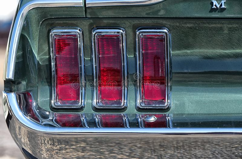Close up, rear tail lights, Ford Mustang. Brooklands, Surrey. royalty free stock photo