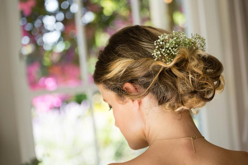 Close up of bride hair with flowers royalty free stock image