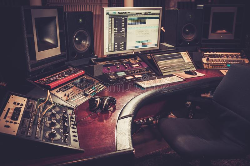 Close-up of recording studio control desk. royalty free stock images