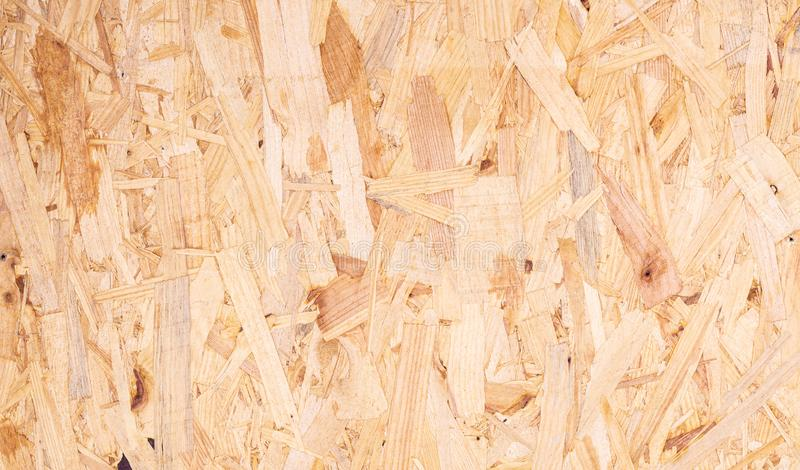 Close up of recycled compressed wood chippings board abstract texture background royalty free stock photos