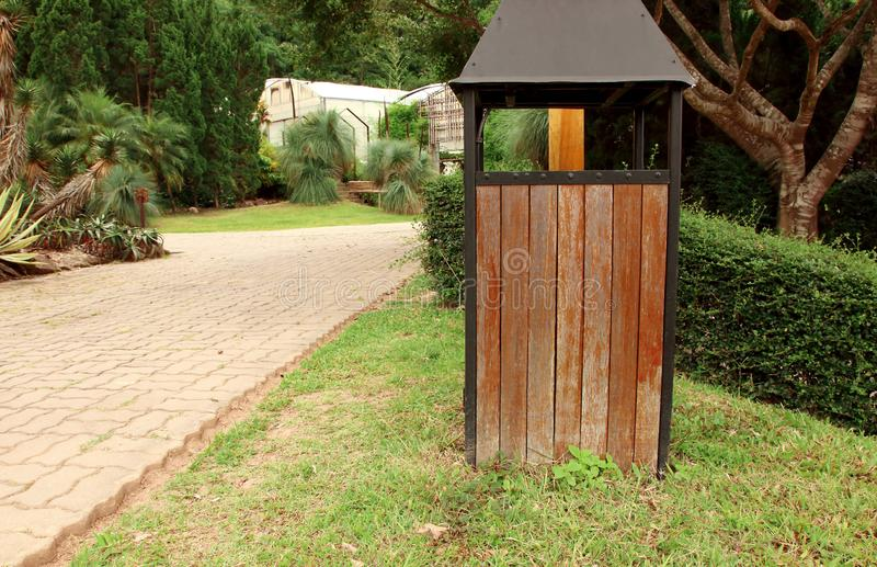 Close up of recycled wooden trash bin in the public park.  stock photos