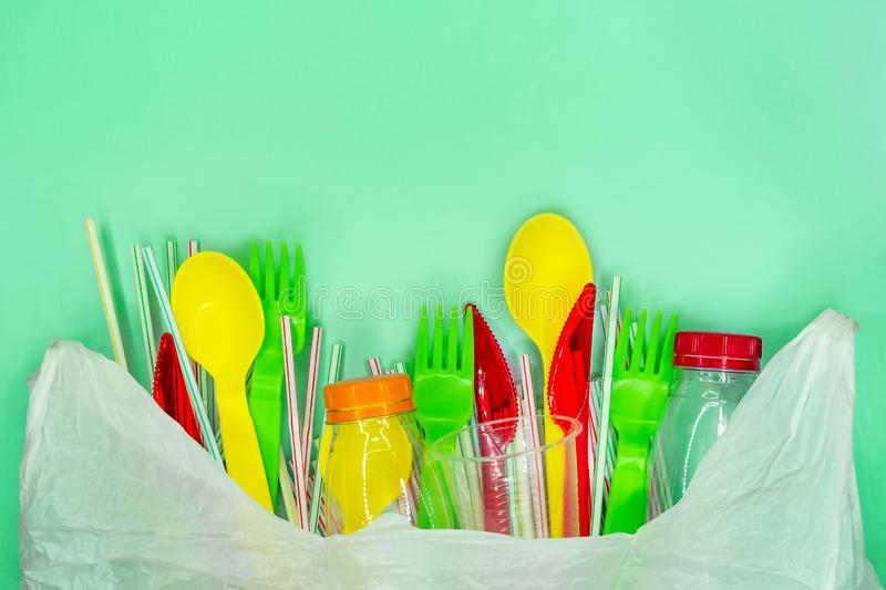 Close up of a Recycling plastic in white bag on green background with copu space royalty free stock photography