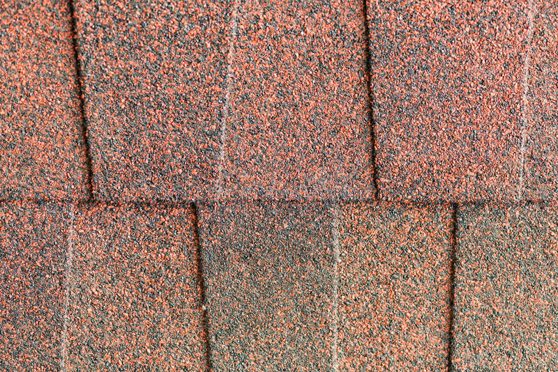 Close up red asphalt shingle background. Red asphalt shingle for roof work stock photo
