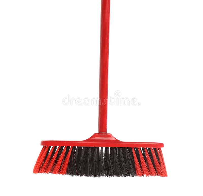 Close up of red black broom. Isolated on a white background royalty free stock images