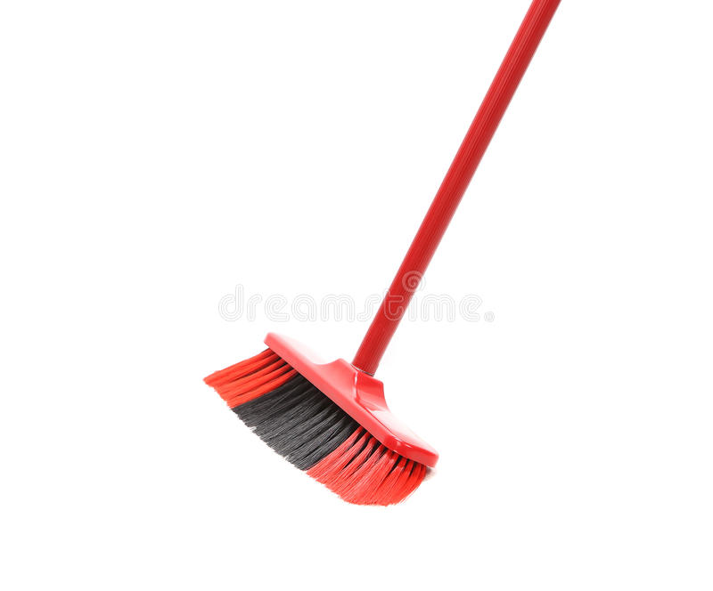 Close up of red black broom. Isolated on a white background stock images