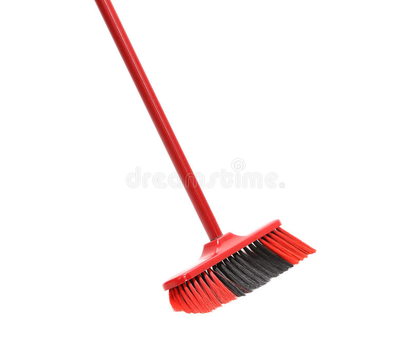 Close up of red black broom. Isolated on a white background royalty free stock image