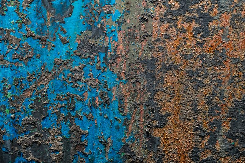Colorful dilapidated wall textured grunge background. Close up of a red and blue dilapidated wall textured grunge background royalty free stock photos