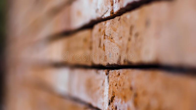 Red brick wall ending in infinity with shallow DOF. Texture of old concept background royalty free stock photography