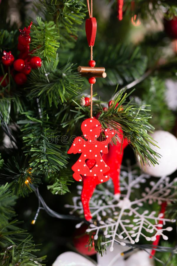 Close up of red christmas angel toy on Christmas tree. Happy New Year and Christmas concept. stock image