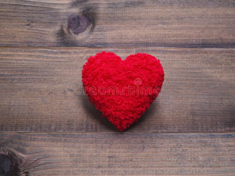 Red cushion heart shape on wood background stock photography