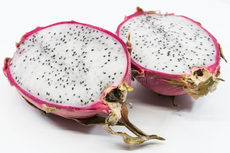 Red dragon fruit sliced in half stock photography