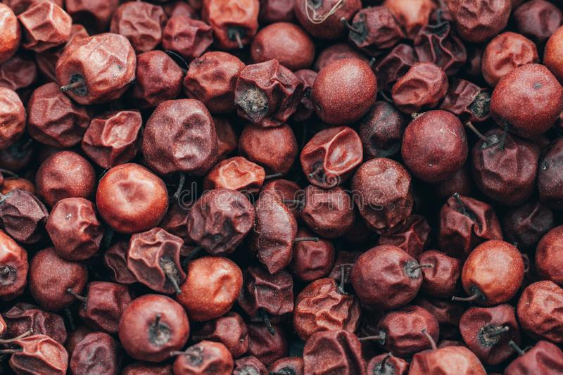 Close Up of Red dried jujube. Ziziphus mauritiana, also known as Chinese date, ber, Chinee apple, jujube, Indian plum, Regi pandu. Indian jujube, dunks in royalty free stock image