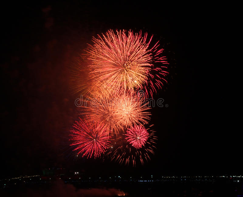 Close-up of a red fireworks display. Close-up of red fireworks exploding symbolizing New Year, celebration and pyrotechnics stock photography
