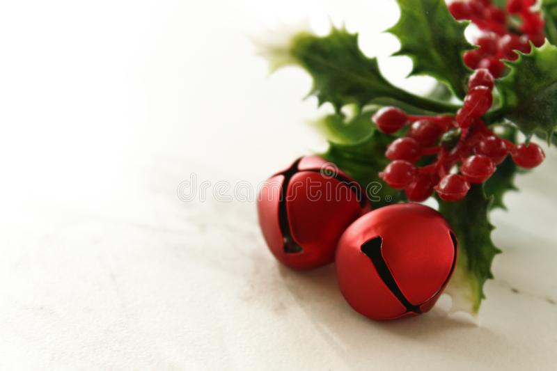 Christmas mistletoe and jingle bells royalty free stock photography