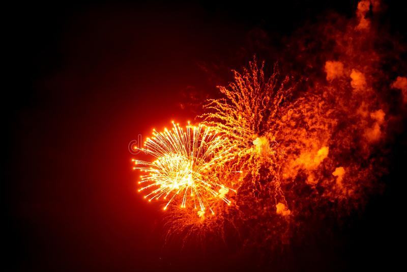 Close-up red and orange festive fireworks on black background. Abstract holiday background stock photos