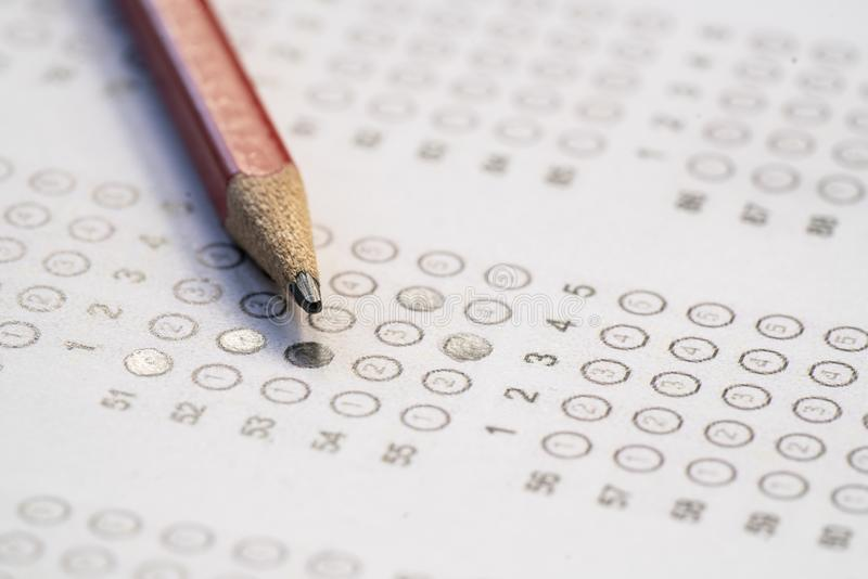 Close up red pencil on answer sheets royalty free stock photo