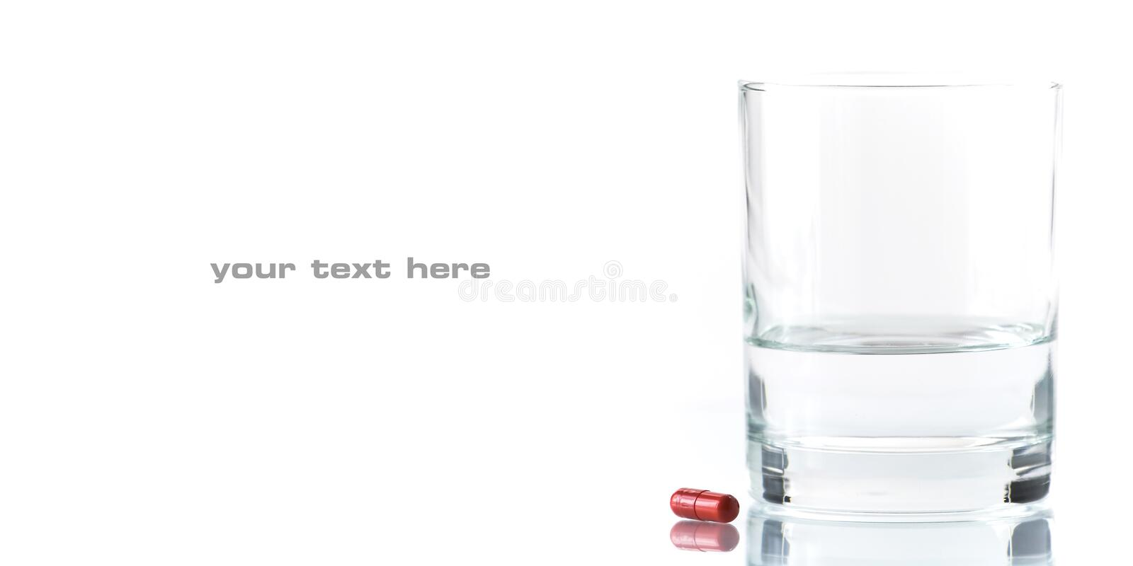 Close up of red pill and water stock photos