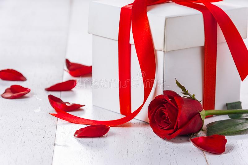 Close-up red rose. On white wooden table royalty free stock photography