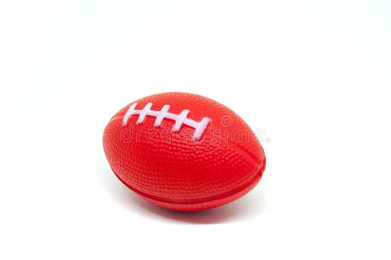 Close up red rugby ball toy for children isolated on white background. royalty free stock photo
