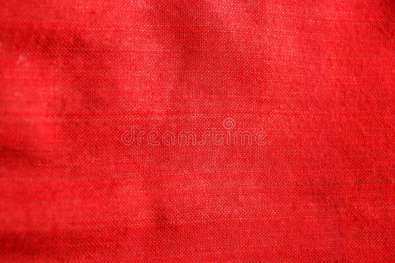 Close-up red traditional fabric cloth texture, textile detail background royalty free stock photography