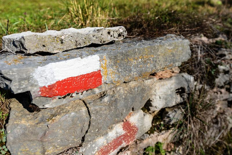 Trail Sign on a Rock in Mountain - Italy royalty free stock photo