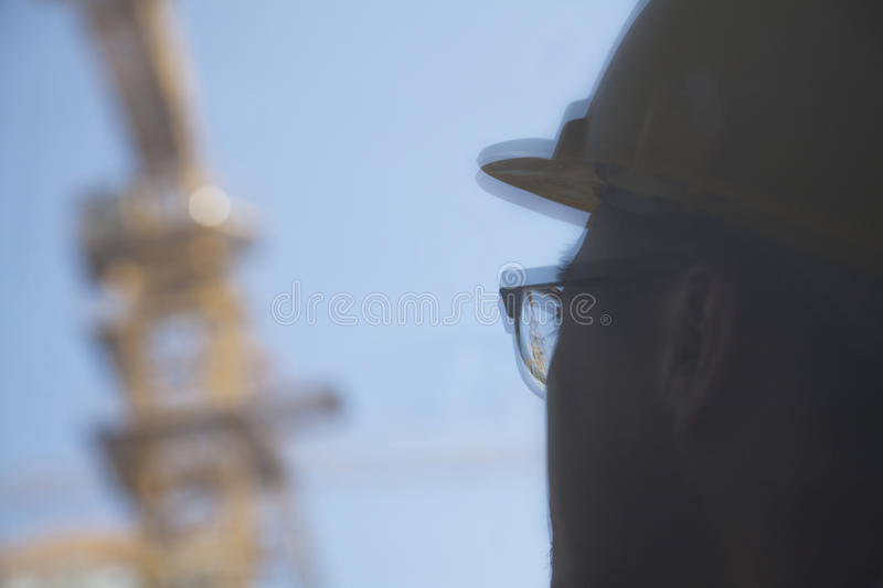 Close-up of reflection of architect on construction site royalty free stock photos