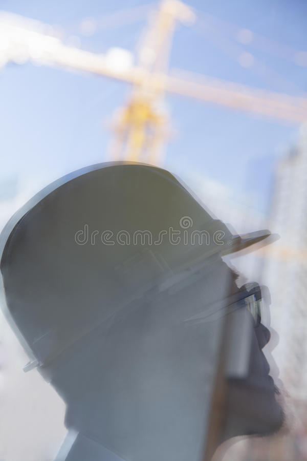 Close-up of reflection of architect on construction site stock photography