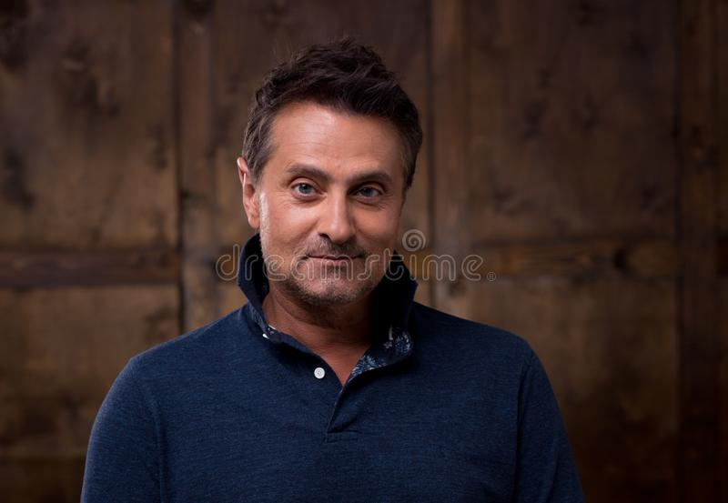 Close up of relaxed middle aged man looking attentively at you royalty free stock images