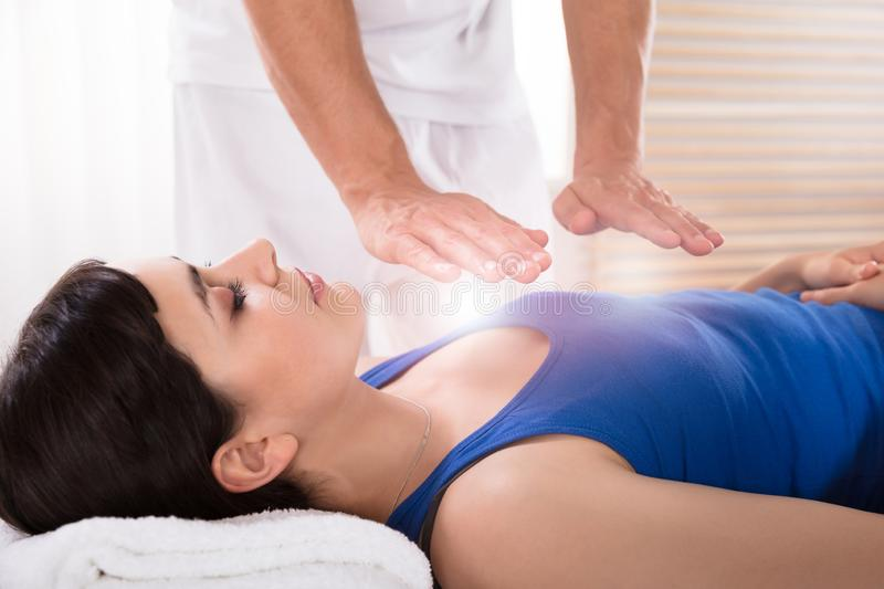 Woman Having Reiki Healing Treatment stock image