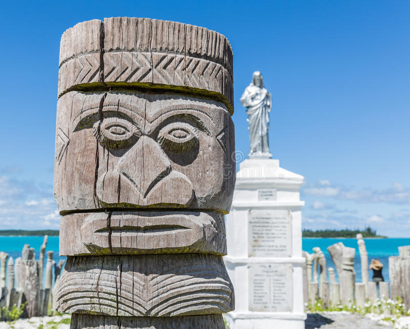 Close up of religeous totem pole. At St Maurice memorial on ÃŽle des Pins (Isle of Pines, Kunie Island), New Caledonia, Pacific Ocean celebrating the first royalty free stock photo