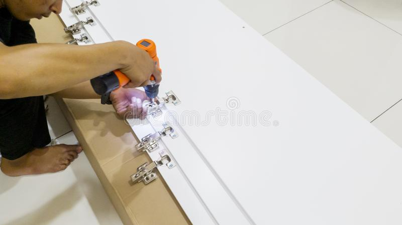 Repairman mounting screws with a drill stock photos