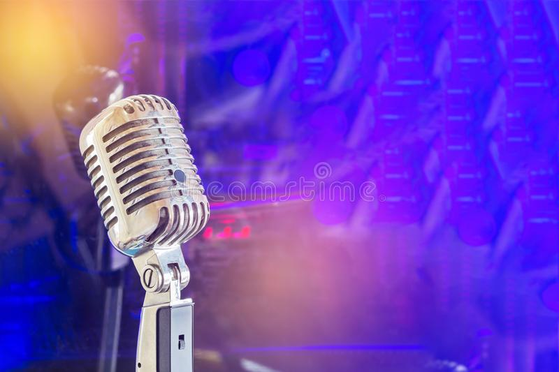 Close up retro microphone on band with color lights background royalty free stock photo