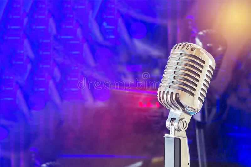 Close up retro microphone on band in nigh concert nd stock image