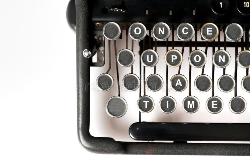 Close up of retro style typewriter, once upon a time. Close up of retro style typewriter in studio, once upon a time stock images