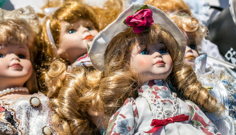 Close-up of retro and vintage porcelain dolls for collection stock photos
