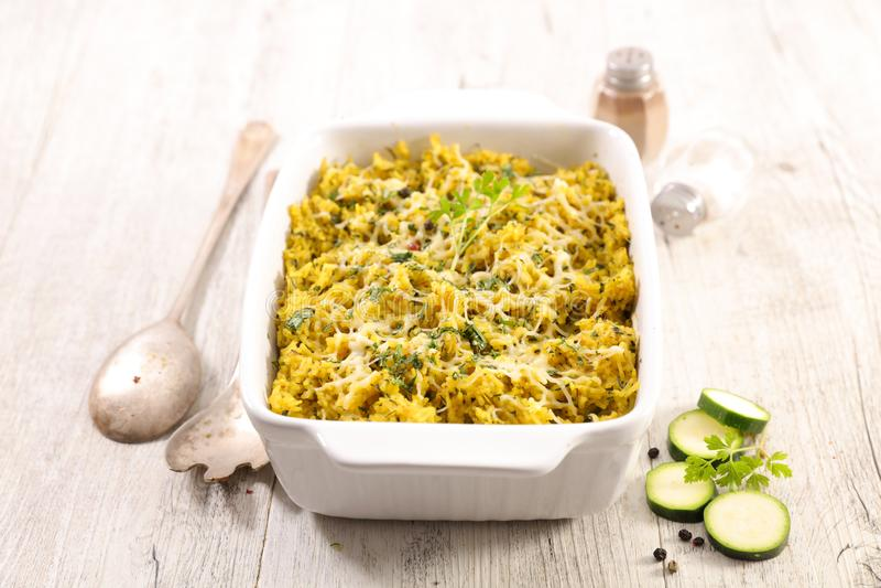 Rice and zucchini gratin stock image