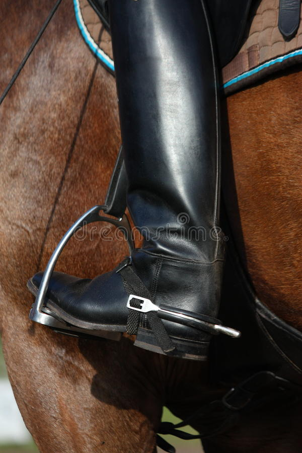 Close up of riding boot with metal spur stock images