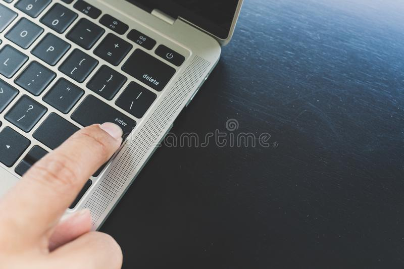 Close up of right hand fingers Of Asian men Deciding to press enter button for laptop stock images