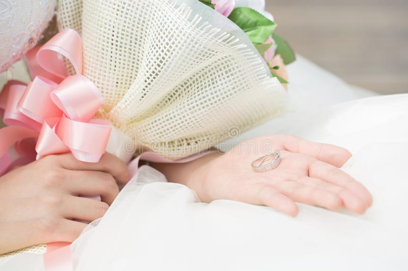 close up ring in hands of the bride beautiful pink stock images