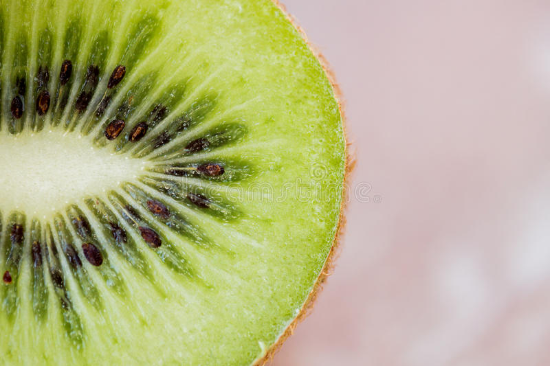 Close up of ripe kiwi slice on table. Fruits, diet, food and objects concept - close up of ripe kiwi slice on table royalty free stock photo