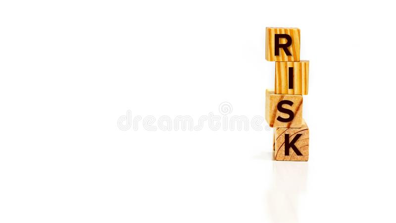 Close up Risk word on multi-colored wooden blocks royalty free stock images