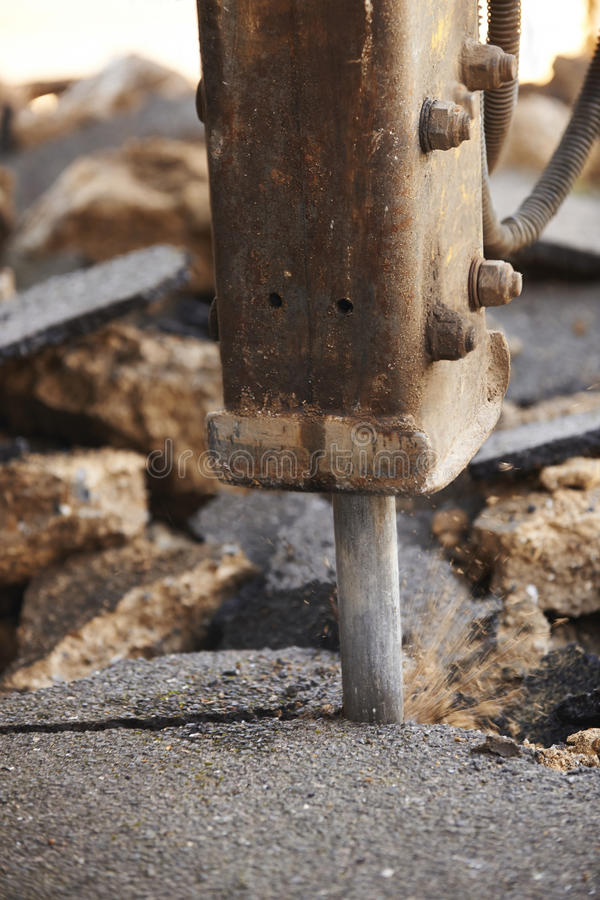 Close Up Of Road Being Dug Up For Repair. Road Being Dug Up For Repair royalty free stock photos