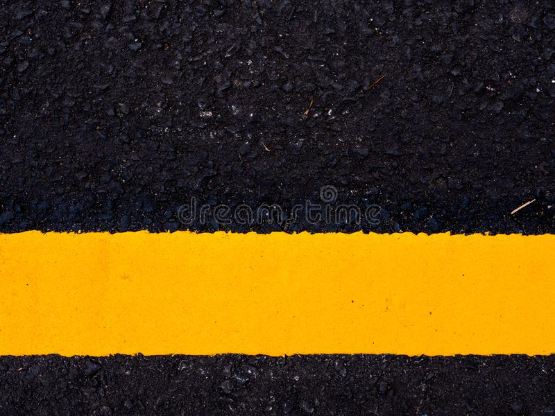 close up road surface, yellow traffic line royalty free stock photography