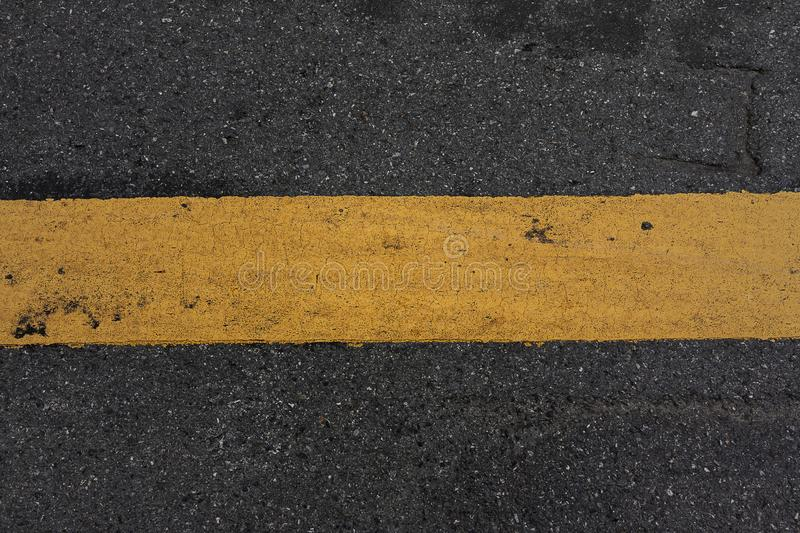 Close-up road texture and yellow stripe stock image