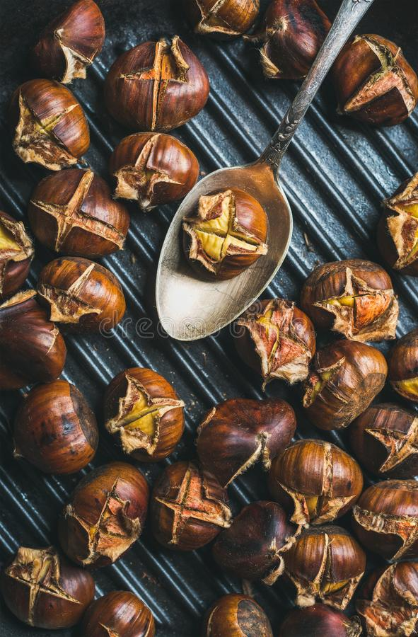 Close-up of roasted chestnuts and metal vintage spoon stock photo